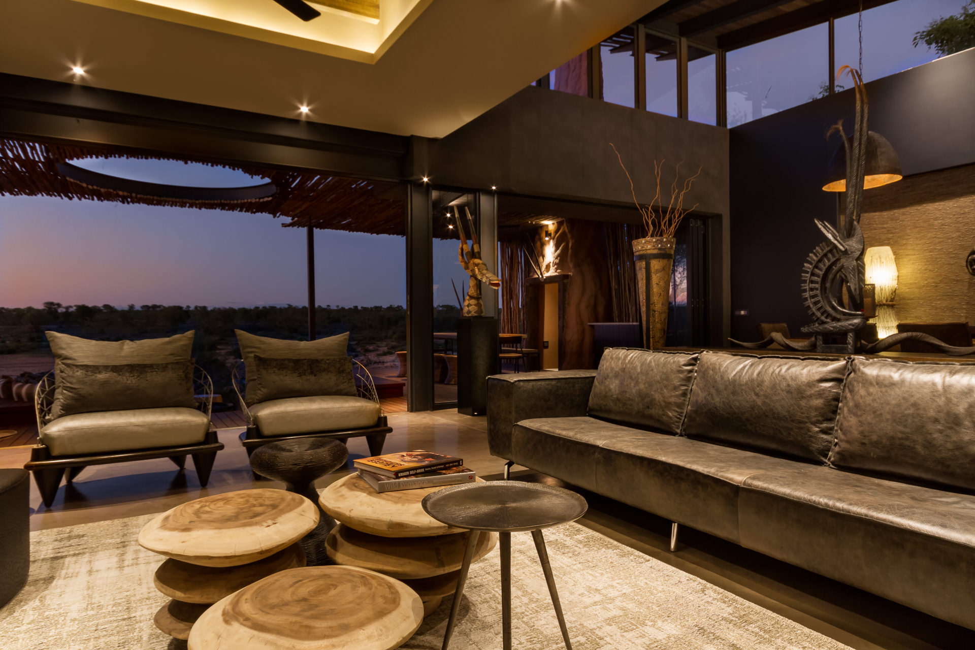 Large lounge with sliding doors that open to outdoor spaces
